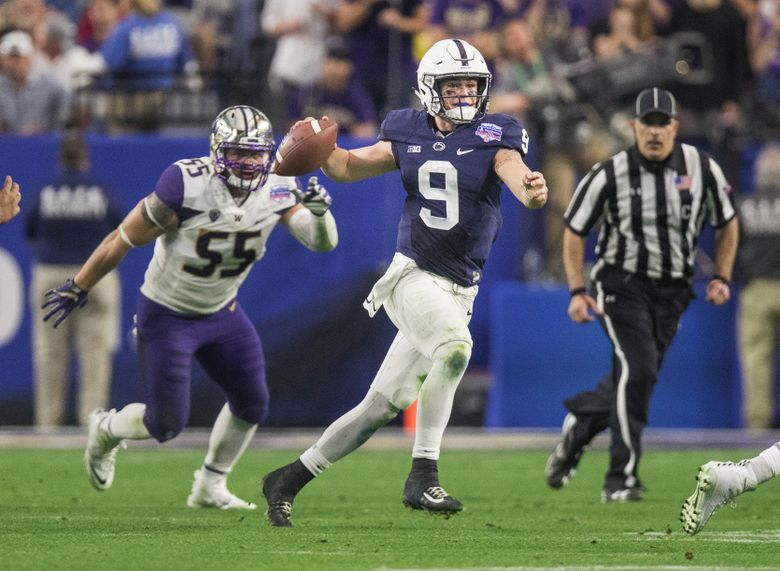 Penn State quarterback Trace McSorley scrambles away from Washington's defenders on Saturday at the Fiesta Bowl. (Dean Rutz/The Seattle Times)