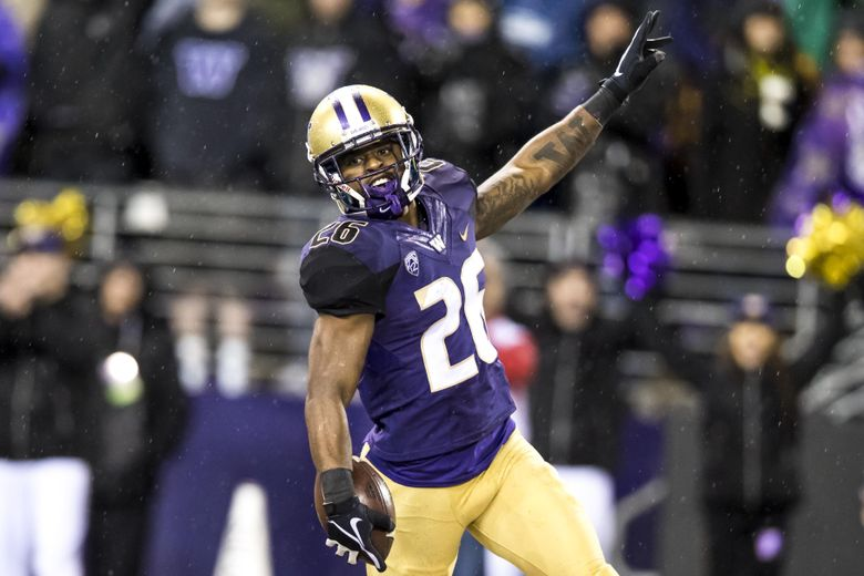 Huskies tailback Salvon Ahmed runs in a 58-yard touchdown against Oregon this season. (Bettina Hansen/The Seattle Times)