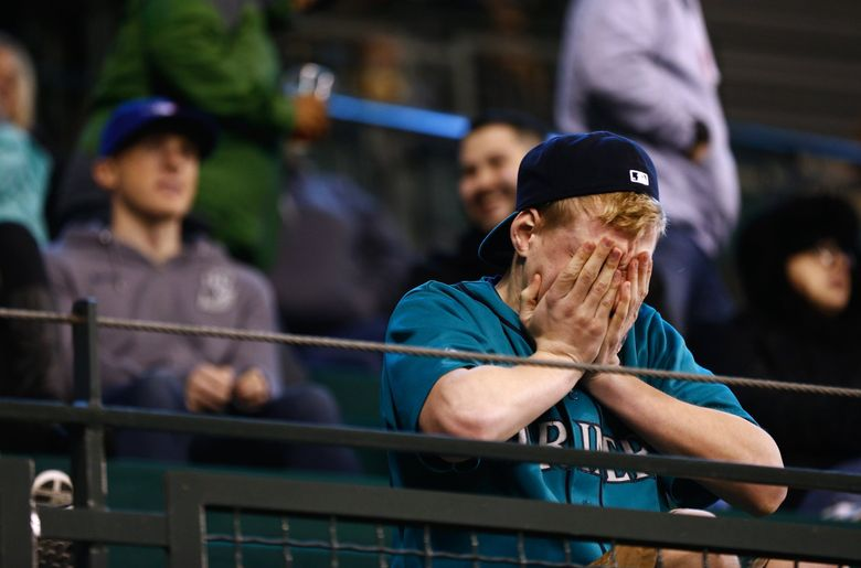 A young fan reacts as Justin Smoak grounds into a double play in the bottom of the 6th inning during a 2-0 loss against the Angels in 2014. (Lindsey Wasson / The Seattle Times)