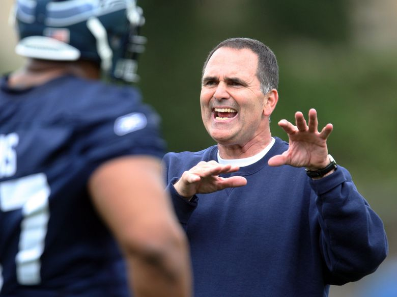 SEATTLE SEAHAWKS MINICAMP – 050208 – New offensive line coach Mike Solari explains a blocking technique as lineman Rob Sims listens during the team's first minicamp of the season.  (ROD MAR / The Seattle Times)