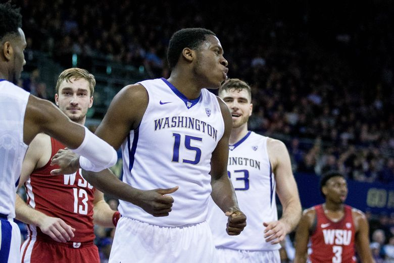 Washington Huskies forward Noah Dickerson (15) cheers after making a basket during the first half at Alaska Airlines Arena in Seattle on Sunday, Jan 28, 2018. At the half, Washington Huskies leads 45-30. (Courtney Pedroza / The Seattle Times)