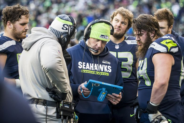 Seahawks offensive line and assistant head coach Tom Cable talks with his unit. (Bettina Hansen / The Seattle Times)