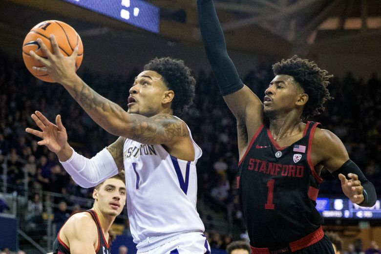 Washington Huskies guard David Crisp (1) makes it past Stanford Cardinal guard Daejon Davis (1) to take a shot during the first half at Alaska Airlines Arena in Seattle, on Saturday.  (Courtney Pedroza / The Seattle Times)