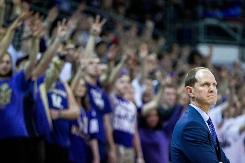 The Dawg Pack cheers behind Washington coach Mike Hopkins in the second half against Washington State.  (Courtney Pedroza / The Seattle Times)