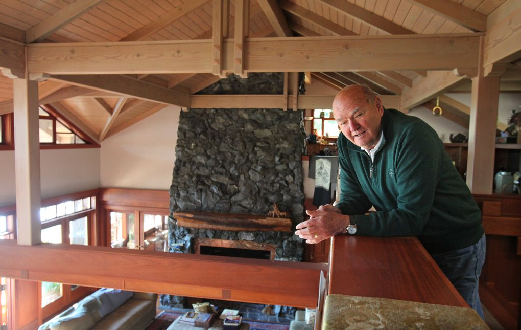Warren Miller looks over the lodge-style living room of his Orcas Island home in October 2010.  (Steve Ringman / The Seattle Times, file)