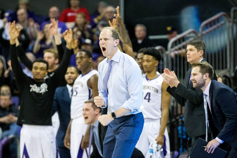 Huskies coach Mike Hopkins cheers for his team during the first half against Stanford at Alaska Airlines Arena on Saturday. (Courtney Pedroza/The Seattle Times)