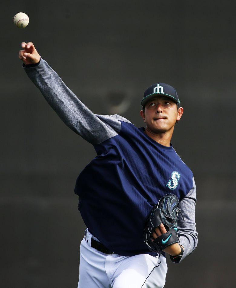 Mariners pitcher Hisashi Iwakuma doing a long toss exercise during the fourth day of spring training. (Ken Lambert / The Seattle Times)