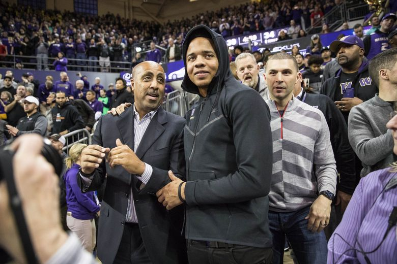 Lorenzo Romar and Markelle Fultz were on hand to watch Isaiah Thomas have his jersey retired. (Dean Rutz / The Seattle Times)