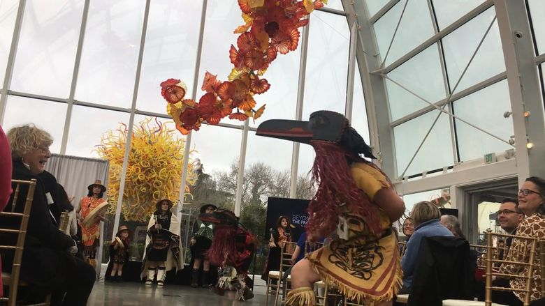 Git-Hoan Dancers perform at a kickoff event for a statewide series of exhibitions that will revisit photographer Edward Curtis' work alongside Native American perspectives and art. (Brendan Kiley / The Seattle Times)