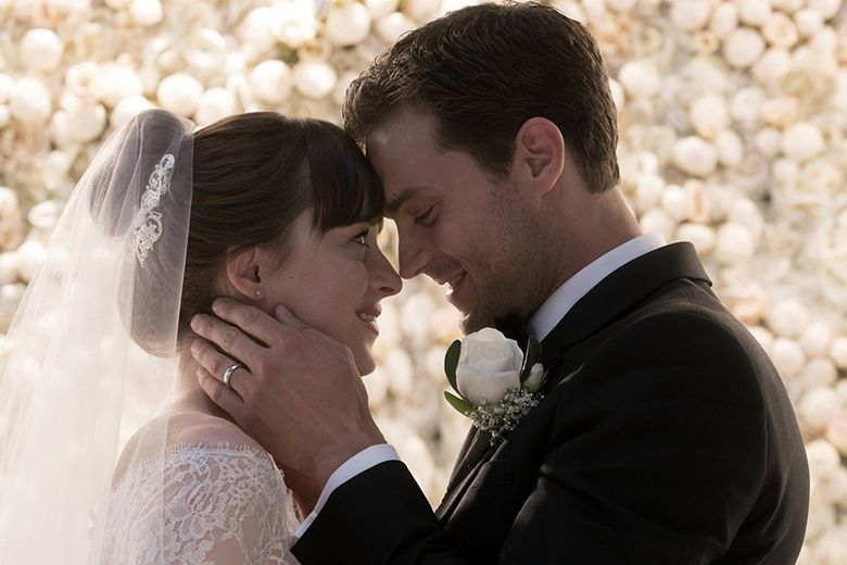 """Dakota Johnson and Jamie Dornan, though, continued another installment of bad chemistry, this time in """"Fifty Shades Freed."""" (Universal Pictures)"""
