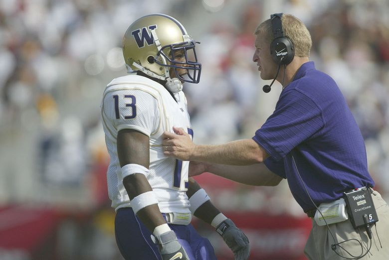 """Nate Robinson gets instruction in 2002 from the sideline. Robinson is claiming that a UW booster offered him """"$100,000 a year"""" to play football for the Huskies. (Dean Rutz / The Seattle Times, file)"""