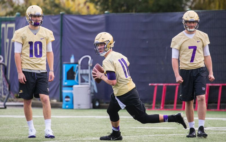 UW quarterback Jacob Sirmon, center, on the first day of spring practice for the UW Husky football team on Wednesday. Wednesday was the first day of spring practice for the UW football team. At left is Jacob Eason and at right is Colson Yankoff. (Mike Siegel / The Seattle Times)