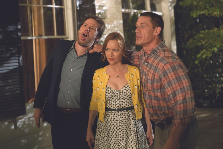 "Ike Barinholtz, left, Leslie Mann and John Cena star in ""Blockers."" (Quantrell D. Colbe / Universal Studios)"