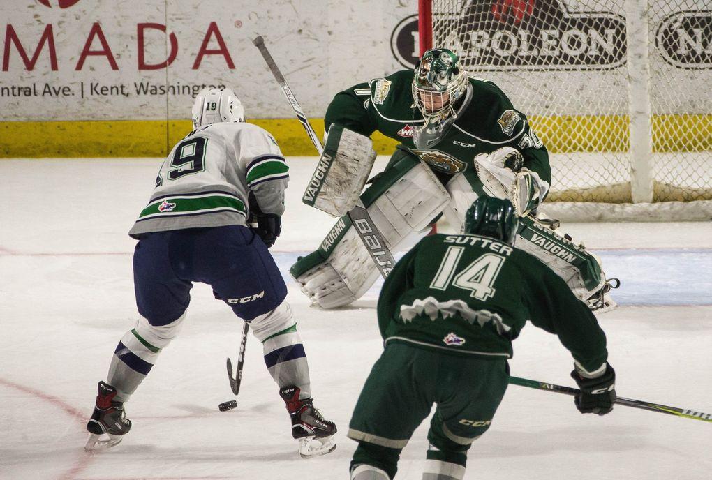 Seattle's Donovan Neuls draws out Everett goalie Carter Hart. (Dean Rutz / The Seattle Times)