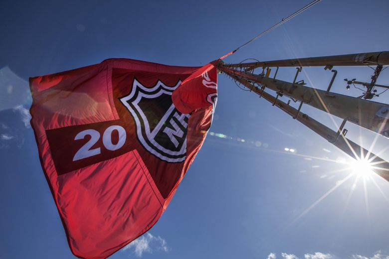 The NHL Seattle group raised a flag on top of the Space Needle in March after their proposed $700-million renovation of KeyArena was approved. (Steve Ringman / The Seattle Times)