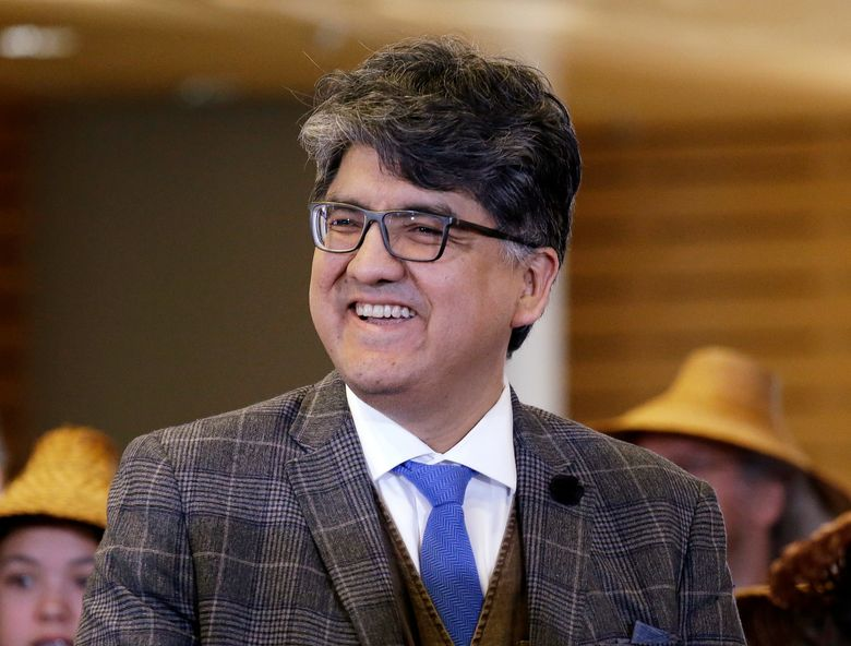 FILE – In this Oct. 10, 2016 file photo, author and filmmaker Sherman Alexie appears at a celebration of Indigenous Peoples' Day at Seattle's City Hall. The American Library Association tells The Associated Press that Alexie has declined the Carnegie Medal he received last month.  (AP Photo/Elaine Thompson, File)