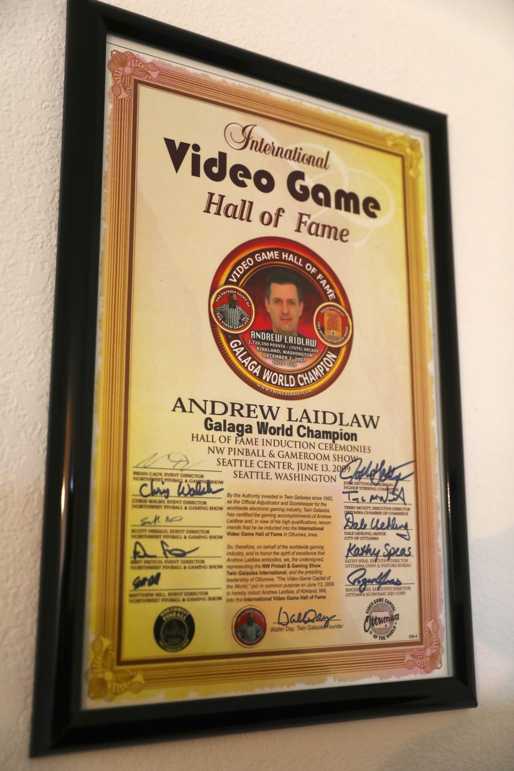 Andrew Laidlaw has the plaque that proves he's the world record holder in Galaga on his wall at home in Kirkland. (Ken Lambert/The Seattle Times)