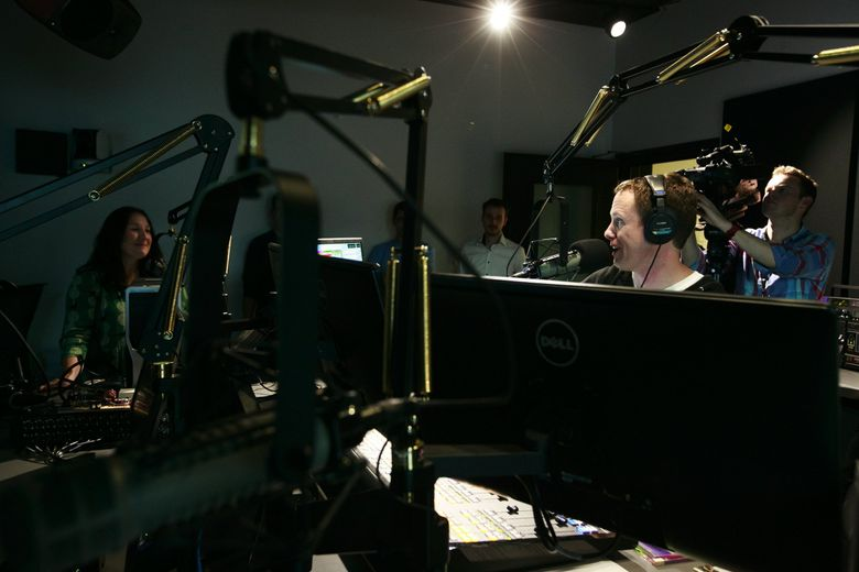 DJ Cheryl Waters, left, and  DJ John Richards during their first broadcasts inside the new KEXP studios at Seattle Center in 2015.  (Erika Schultz / The Seattle Times)