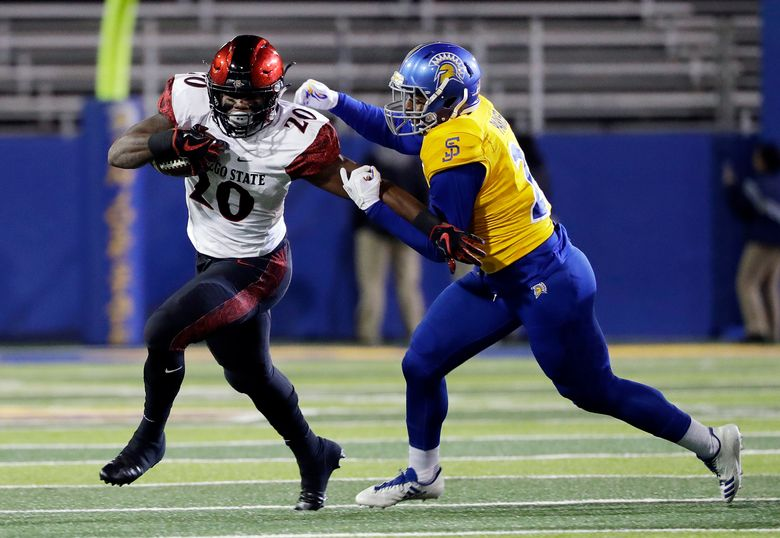 San Diego State running back Rashaad Penny, right, was drafted 27th overall by the Seattle Seahawks in the first round of the NFL Draft on Thursday, April 26. (AP Photo/Marcio Jose Sanchez)
