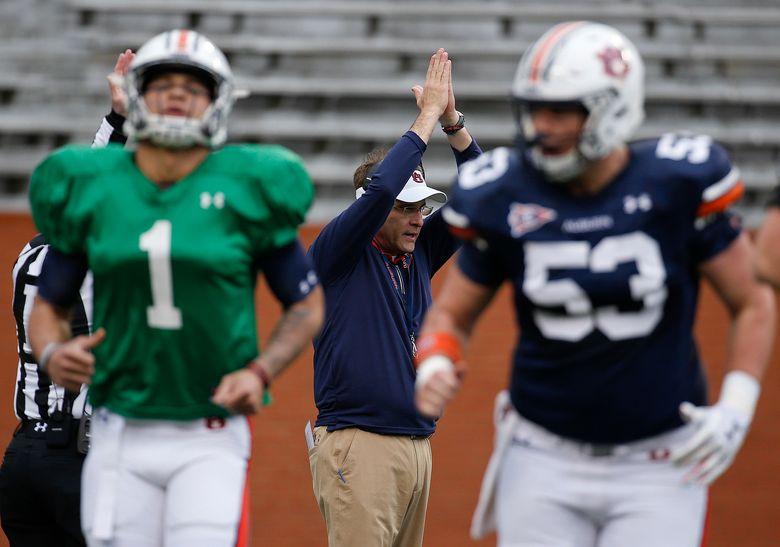 Auburn head coach Gus Malzahn, center, gestures during the first half of a spring NCAA college football game, Saturday, April 7, 2018, in Auburn, Ala. (AP Photo/Brynn Anderson)