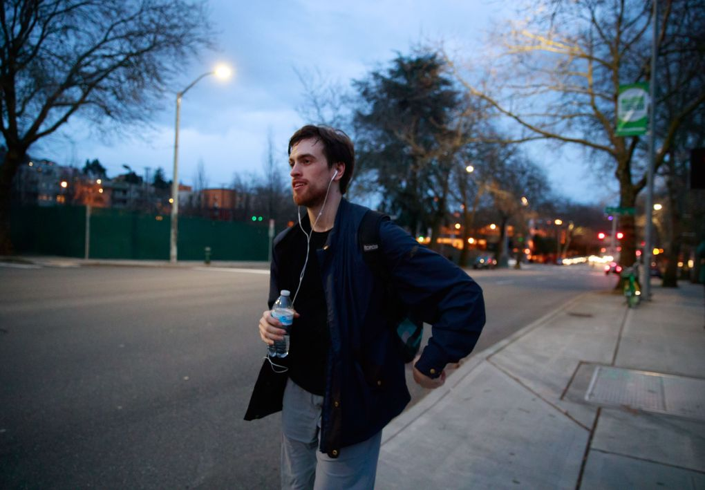 """Steven Loch walks home  from Pacific Northwest Ballet headquarters on a recent evening. """"I think the one thing that I would describe myself as is joyful."""" he says. """"I'm pretty optimistic. I love to be goofy and fun.""""  (Erika Schultz / The Seattle Times)"""