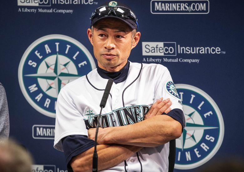 Ichiro talks to reporters outside the Mariners clubhouse about the decision to stop playing this season and move into a front-office role. (Dean Rutz / The Seattle Times)