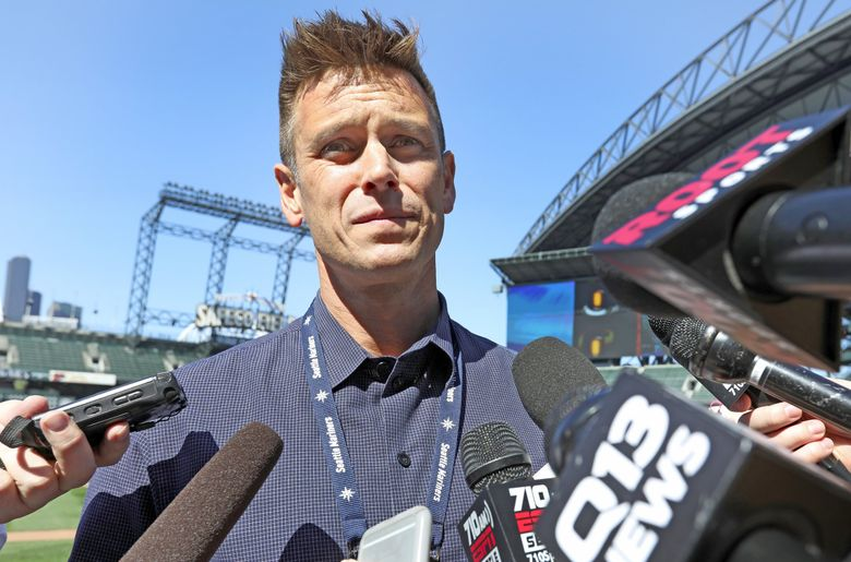Mariners general manager Jerry Dipoto talks to reporters after second baseman Robinson Cano drew an 80 game suspension. (Ken Lambert / The Seattle Times)
