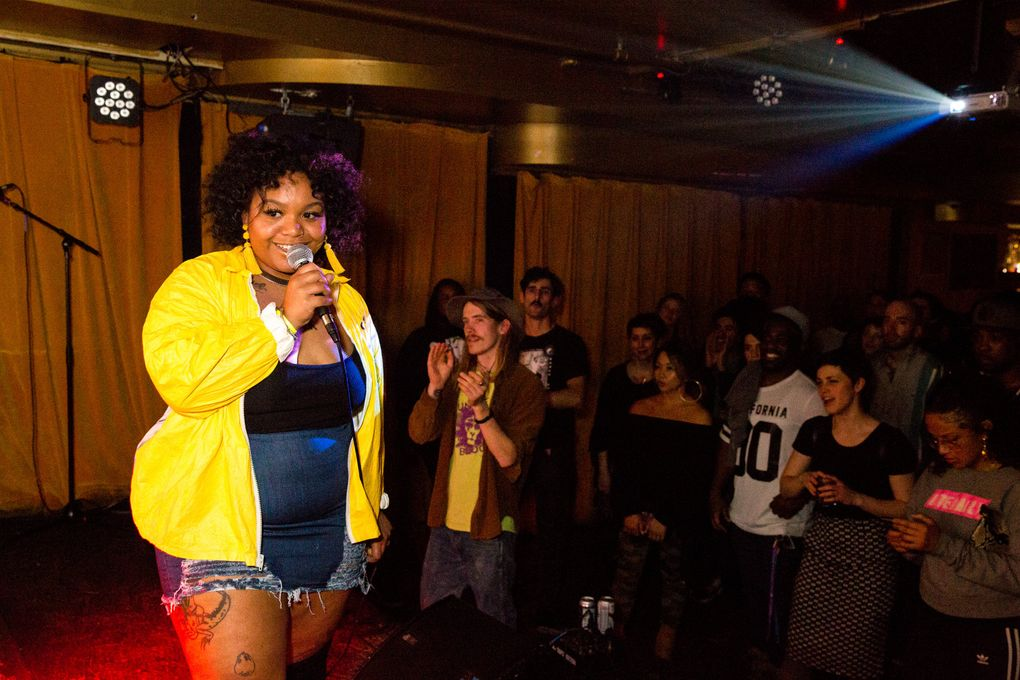 JusMoni sings at Barboza on Capitol Hill in Seattle. The 25-year-old works at The Station coffee shop on Beacon Hill by day, and by night performs at venues around the city. (Courtney Pedroza / The Seattle Times)