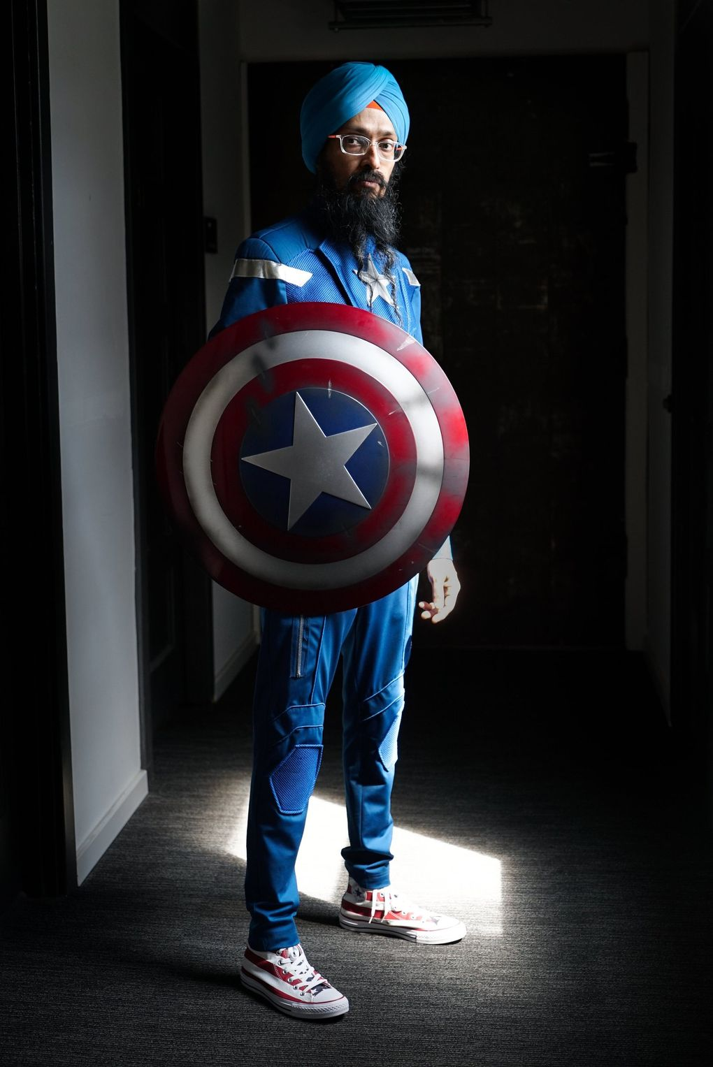 Vishavjit Singh, dressed as Sikh Captain America, uses his superhero alter ego to initiate conversations he would not normally have with others while wearing his civilian clothes. (Corinne Chin / The Seattle Times)