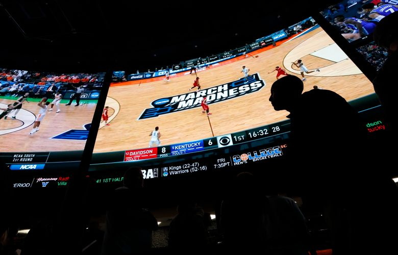 People wait in line to bet on the NCAA college basketball tournament at the Westgate Superbook sports book Thursday, March 15, 2018, in Las Vegas. (AP Photo/John Locher) (John Locher/AP)
