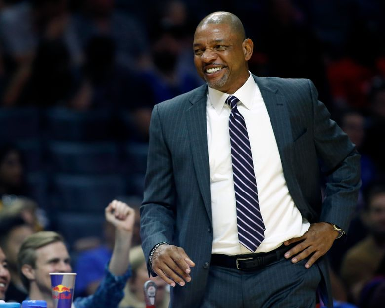 FILE – In this Oct. 8, 2017, file photo, Los Angeles Clippers head coach Doc Rivers smiles during the second half of a preseason NBA basketball game against the Portland Trail Blazers, in Los Angeles. The Clippers and coach Doc Rivers have agreed to a contract extension that will keep him around to oversee the post-Lob City era. The team announced the extension Wednesday, May 23, 2018, while not disclosing terms of the deal.(AP Photo/Alex Gallardo, FIle)