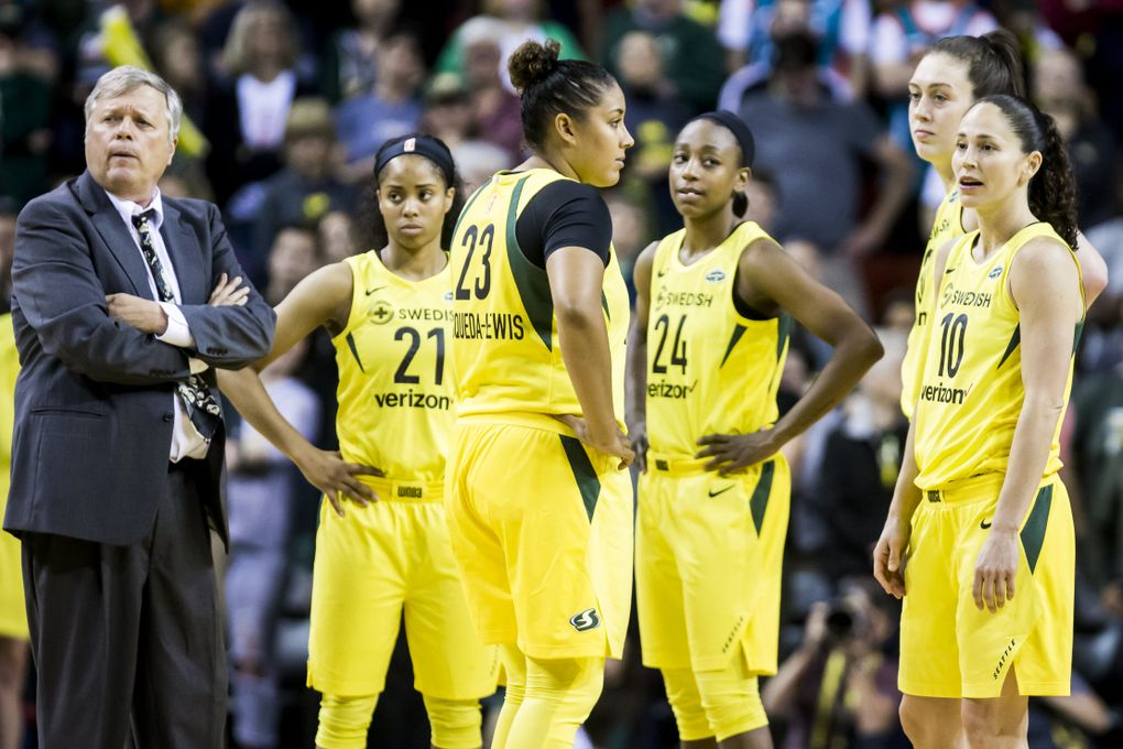 From left, head coach Dan Hughes, guard Jordin Canada, forward Kaleena Mosqueda-Lewis, guard Jewell Loyd, forward Breanna Stewart and guard Sue Bird wait for a referee review in the final moments of the season opener May 20. Down three points in the final moments, they lost possession when Stewart's foot went out of bounds.  (Bettina Hansen / The Seattle Times)