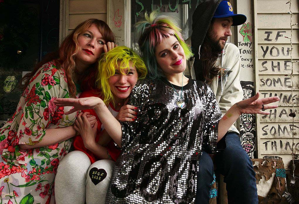"""Since leaving her full-time job at The Stranger, Emily Nokes of Tacocat, second from right, has tightened her belt. When surprise expenses hit, like a car accident or medical issue, Nokes says she has to """"triple hustle"""" with freelance jobs """"and hope that it all works out. But it always does. At least so far.""""  (Erika Schultz/The Seattle Times, 2016)"""