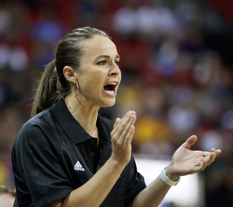 FILE – In this July 11, 2015 file photo, Becky Hammon coaches the San Antonio Spurs during an NBA summer league basketball game against the New York Knicks in Las Vegas.  Hammon plans to interview for the Milwaukee Bucks' coaching job, a person familiar with the search told The Associated Press. The person requested anonymity because the team does not comment on potential candidates. A woman has never been a head coach in the NBA. Hammon is the first female assistant in the league. (AP Photo/Ronda Churchill, File)