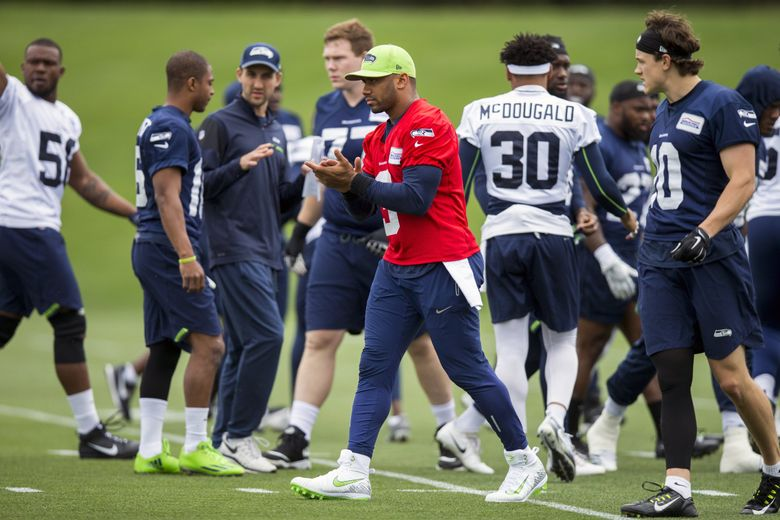 Seahawks quarterback Russell Wilson encourages his teammates as the Seattle Seahawks hold minicamp at the Virginia Mason Athletic Center in Renton Tuesday June 13, 2018. (Bettina Hansen / The Seattle Times)