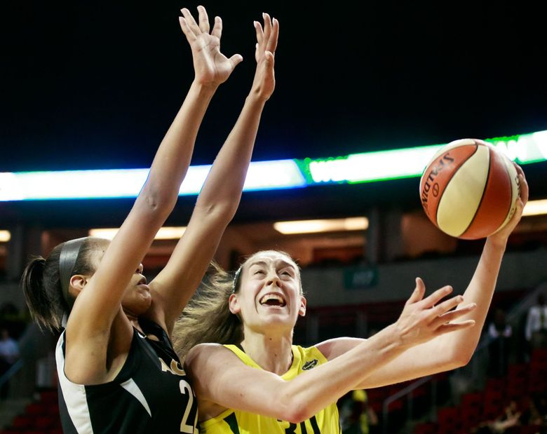Seattle Forward Breanna Stewart (30) drives to the basket as Las Vegas center A'ja Wilson (22) guards during the second quarter of the Seattle Storm versus Las Vegas Aces game at KeyArena in Seattle Tuesday, June 19, 2018. (Erika Schultz / The Seattle Times)