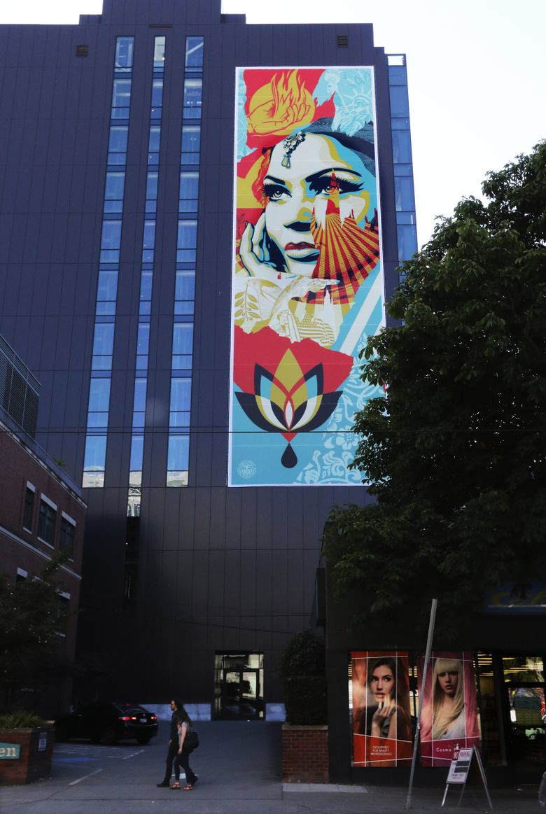 The giant artwork is visible from the corner of Thomas Street and Westlake Avenue North in South Lake Union. (Alan Berner / The Seattle Times)