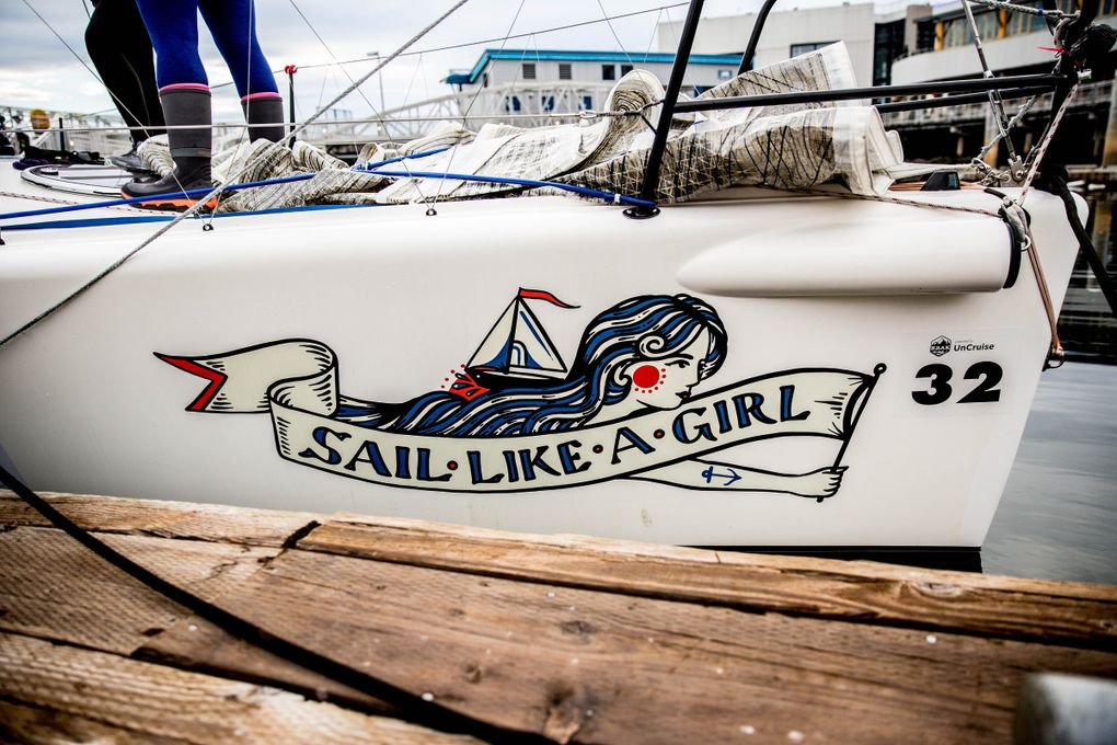 The Sail Like a Girl team name and emblem is painted on the side of the Melges 32. (Rebekah Welch / The Seattle Times)