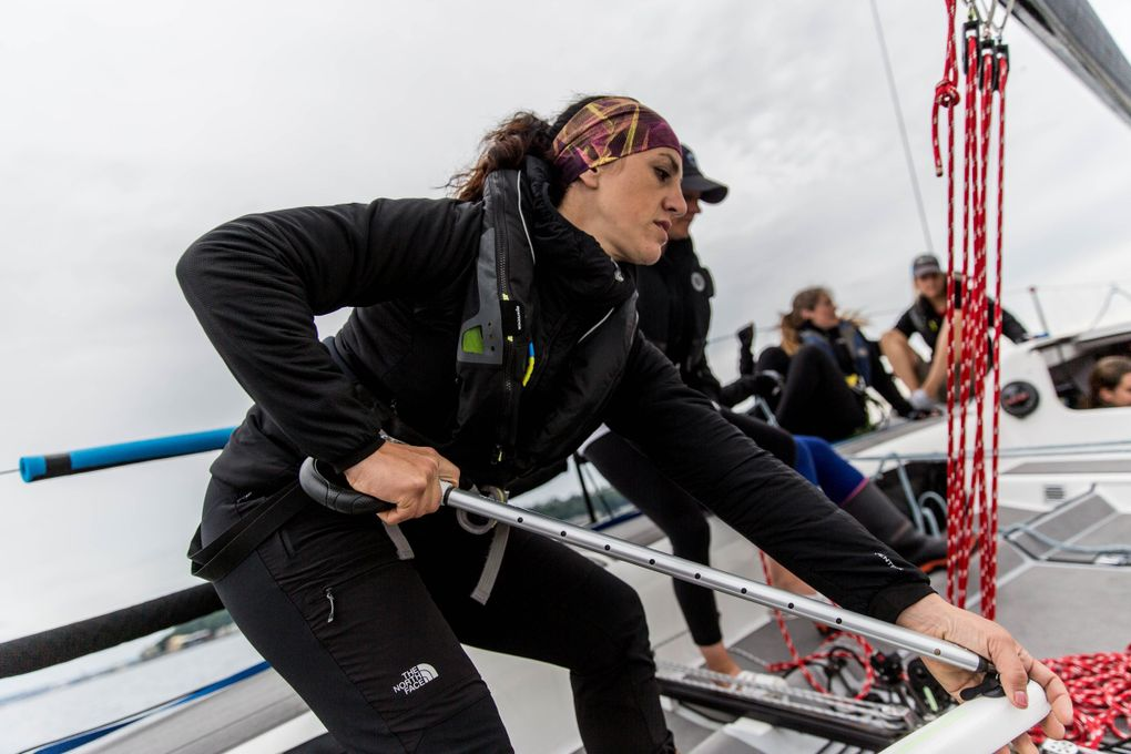 Jeanne Goussev, co-captain and owner of the Melges 32 that the team used in the race, keeps her post at the helm as the team tacks, or turns the bow of the boat to the wind.  (Rebekah Welch / The Seattle Times)
