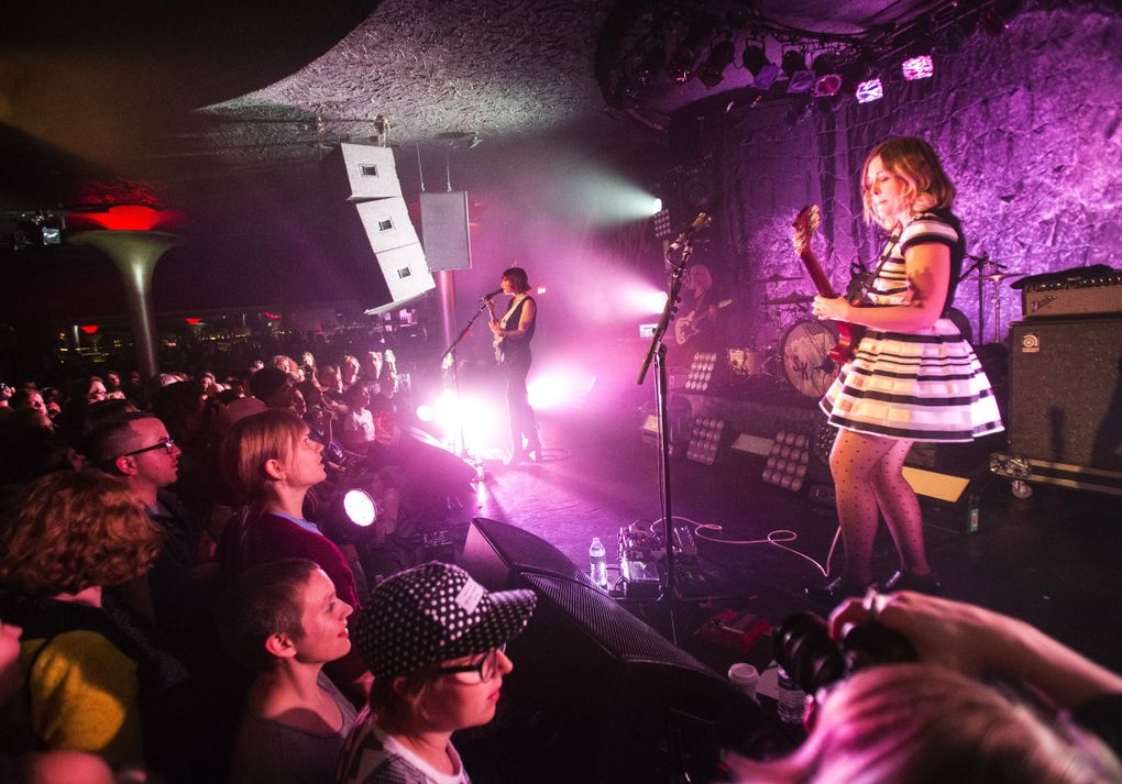 Guitarists and vocalists Carrie Brownstein, left, and Corin Tucker, right, perform as Sleater-Kinney on May 7, 2015, at The Showbox in Seattle. (Lindsey Wasson / The Seattle Times)