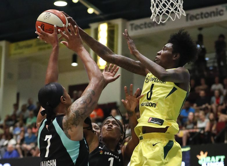 Seattle Storm forward Natasha Howard (6) battles for a rebound against New York Liberty center Kia Vaughn (7) and guard Shavonte Zellous (1) during the first quarter of a WNBA basketball game Tuesday, July 3, 2018, in White Plains, N.Y. (AP Photo/Julie Jacobson) NYJJ104 NYJJ104 (Julie Jacobson / The Associated Press)