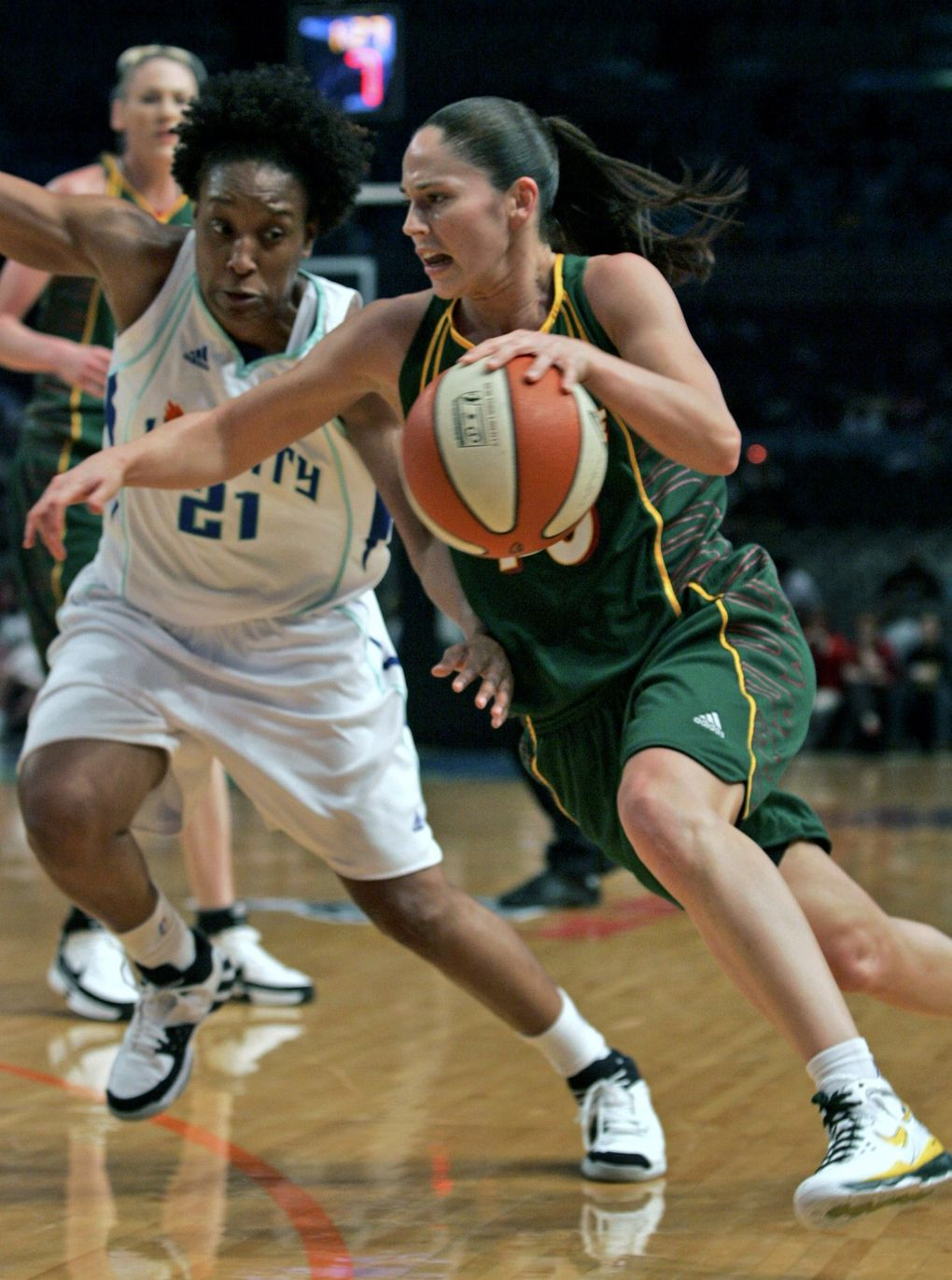 Seattle Storm's Sue Bird, right, drives past New York Liberty's Loree Moore (21) during the first half of a WNBA basketball game Tuesday, June 3, 2008  in New York.  (AP Photo/Frank Franklin II) NYFF102  (Frank Franklin II / The Associated Press)