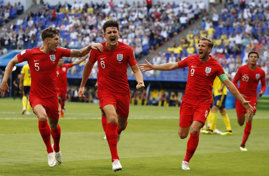 England's Harry Maguire, center, celebrates with his teammates after scoring the opening goal of their 2-0 quarterfinal win over Sweden at the 2018 World Cup. (Francisco Seco / The Associated Press)