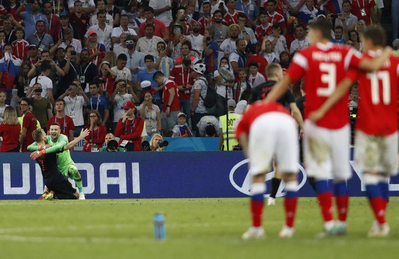 Croatia goalkeeper Danijel Subasic, right, celebrates Ivan Rakitic after their win over Russia in penalty kicks in the 2018 World Cup quarterfinals. (Rebecca Blackwell / The Associated Press)