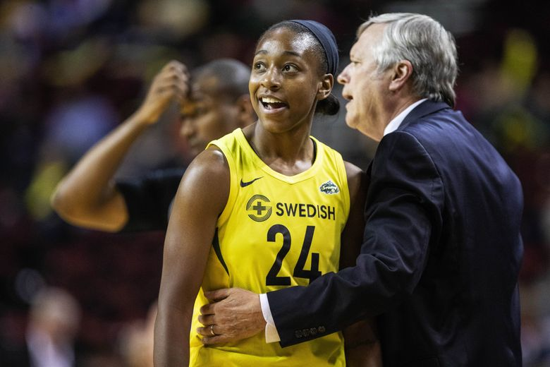 Jewell Loyd, pictured with coach Dan Hughes in a May 31 game, scored 29 points as the Storm beat Phoenix on Tuesday. (Dean Rutz/The Seattle Times)