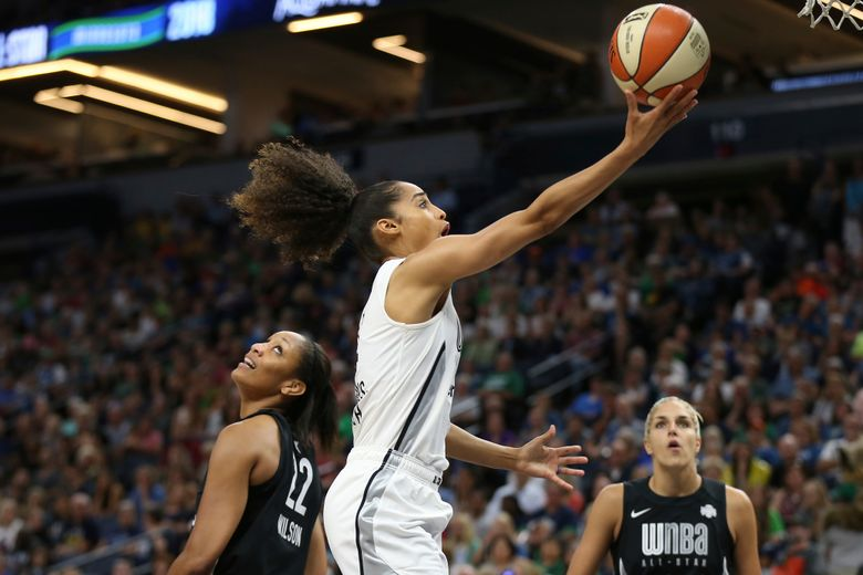 Skylar Diggins-Smith, middle, of the Dallas Wings, playing for Team Parker, goes to the hoop past Team Delle Donne's A'ja Wilson (22) in the WNBA All-Star Game Saturday in Minneapolis. (Stacy Bengs/AP)