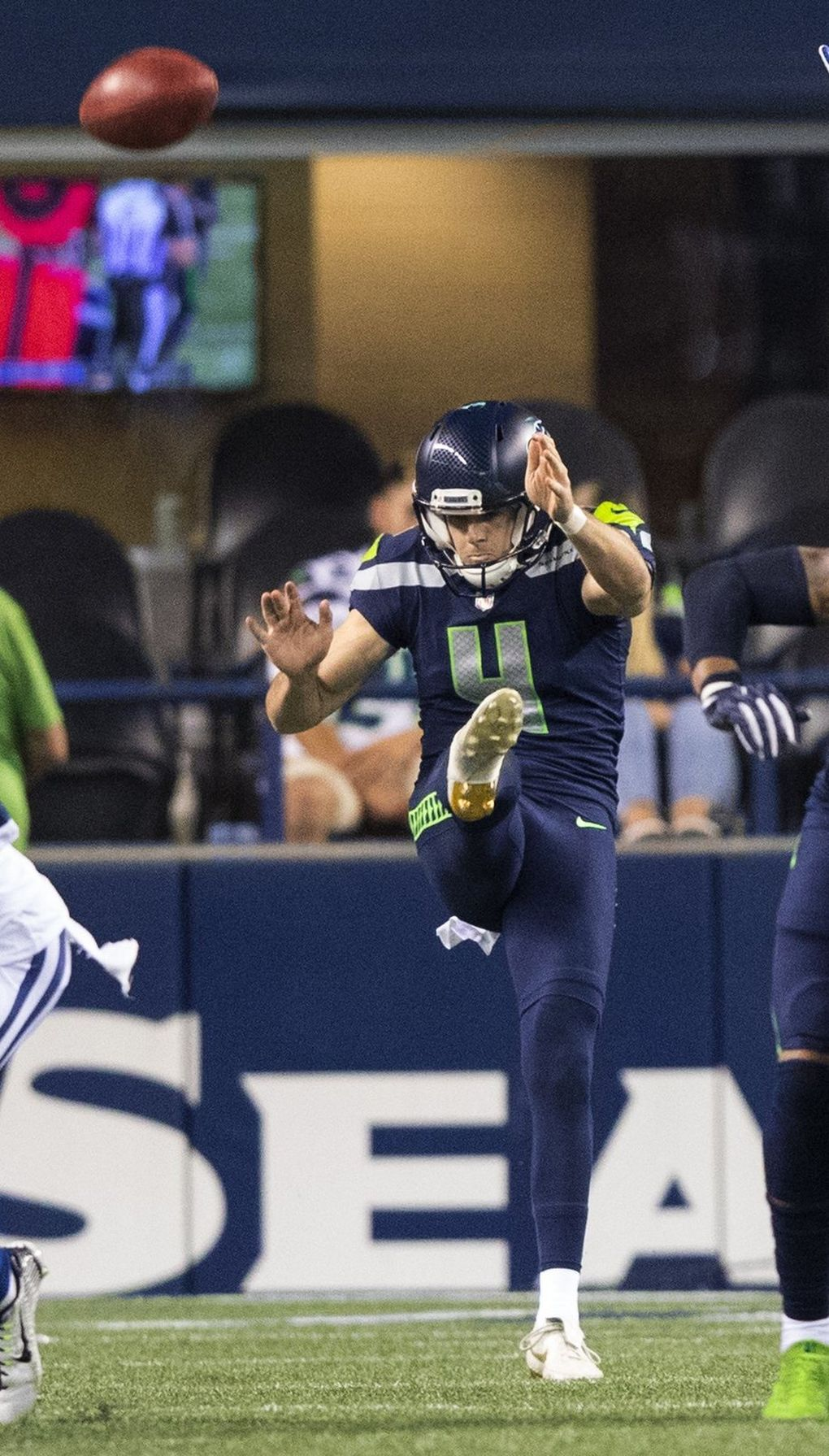 Seattle Seahawks punter Michael Dickson (4) punts during 4th quarter action as the Seattle Seahawks play the Indianapolis Colts on Thursday. (Mike Siegel / The Seattle Times)