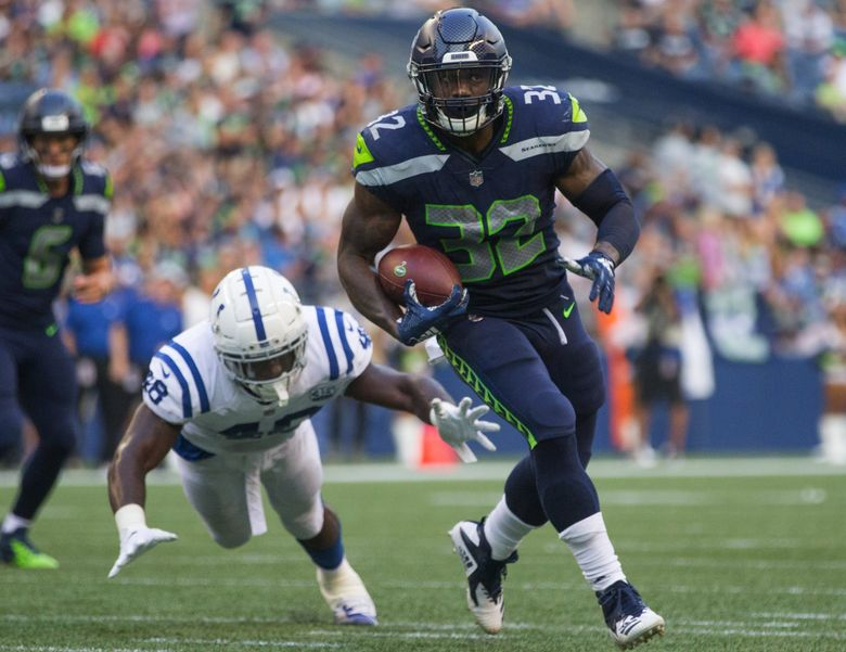 Seattle Seahawks running back Chris Carson (32) makes a first half run as the Seattle Seahawks play the Indianapolis Colts on Thursday. (Mike Siegel / The Seattle Times)