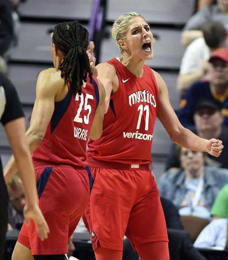 In this June 13, 2018, file photo, Washington Mystics forward Elena Delle Donne (11) celebrates with teammate Monique Currie. (Sean D. Elliot / The Associated Press)