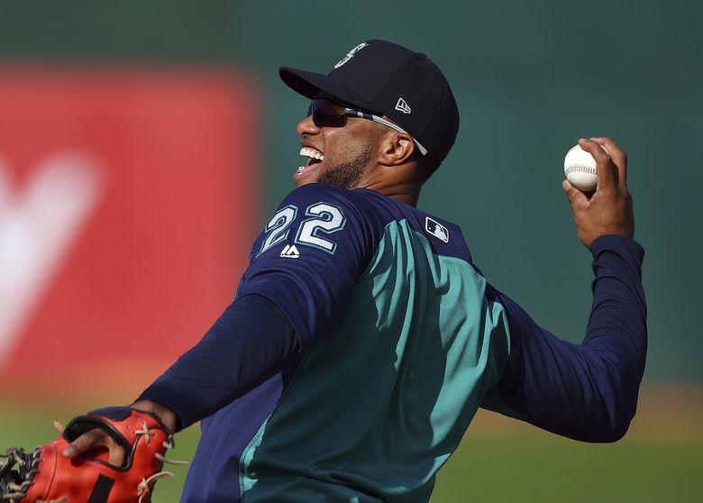 Robinson Cano smiles as he warms up Aug. 14. (Ben Margot / The Associated Press)